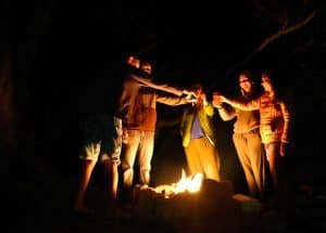Friends Gathered Around the Campfire for a Toast
